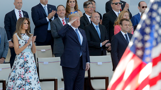 French President Emmanuel Macron, right, U.S. President Donald Trump and U.S. First Lady Melania Trump watch the traditional Bastille Day military parade on the Champs Elysees, in Paris, Friday, July 14, 2017. (AP Photo/Michel Euler)