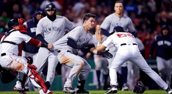 (AP Photo/Charles Krupa). New York Yankees' Tyler Austin, center, rushes Boston Red Sox relief pitcher Joe Kelly, right, after being hit by a pitch during the seventh inning of a baseball game at Fenway Park in Boston, Wednesday, April 11, 2018