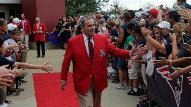 Former New England Patriot announcer Gil Santos outside the Patriot's Hall of Fame prior to an NFL football training camp in Foxborough, Mass., Wednesday, Aug. 5, 2015 (AP Photo/Charles Krupa)