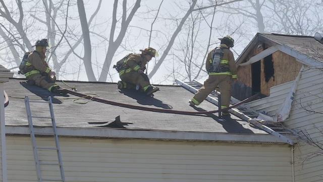 Crews douse fire that tore through apartment complex