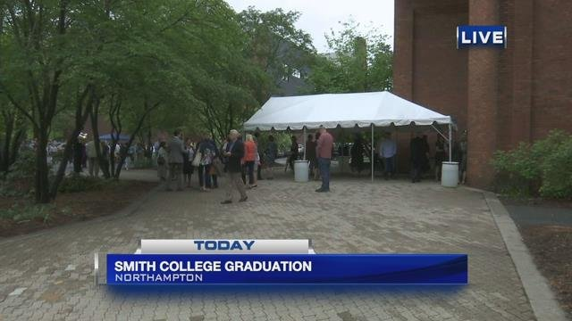 Students of Smith College walk stage for commencement