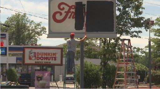 Crews were seen painting over the Friendly's sign on Tuesday (Western Mass News photo)