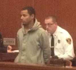 Dennis Rosa Roman stood at his arraignment Tuesday afternoon