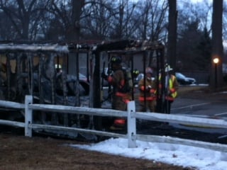 Agawam Firefighters extinguished a car fire after it exploded while inside of a trailer.