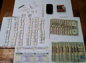 State police confiscated 591 bags of heroin and cash following a traffic stop.