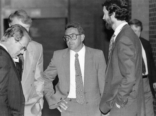 Adolfo Bruno speaks with attorneys in the hallway of the Hampden County Superior Court during a recess in his trial for attempted murder. May 3, 1993 (The Republican)