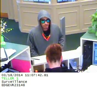 Digital surveillance photos from a camera during the bank robbery this morning at the United Bank at 459 Main St. in Indian Orchard.