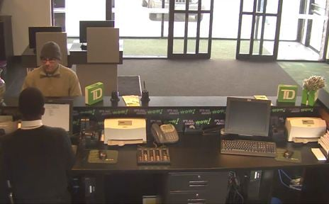 The suspect stands at the counter of the TD Bank on Boston Road during Wednesday's robbery.