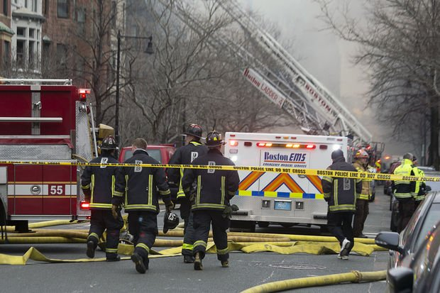 Firefighters battled a 9-alarm blaze on Beacon Street in Boston March 26.