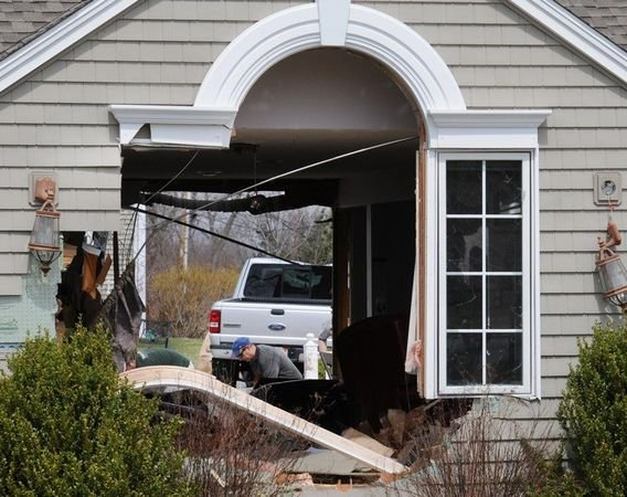 A Ford Ranger was driven through a house in East Forest Park Monday afternoon. (MassLive).