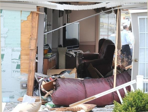 No one was inside at the time of the crash, but the family's dog was asleep underneath a living room couch when the accident occurred. (MassLive).