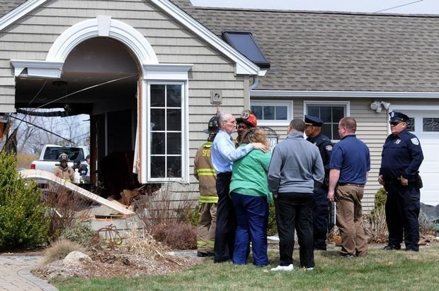 The homeowners were visibly upset after the crash. (MassLive).