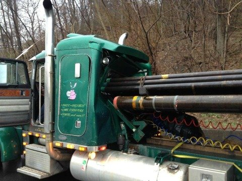 35,000 pounds of pipes punctured a tractor trailer cab on I-91 northbound Tuesday morning.