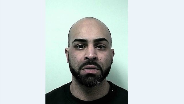 Mug shot of 29-year-old Christopher Burgos.