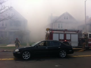 Heavy smoke could be seen coming from the house at 28 Wesson St. (Stephanie Hallowell).