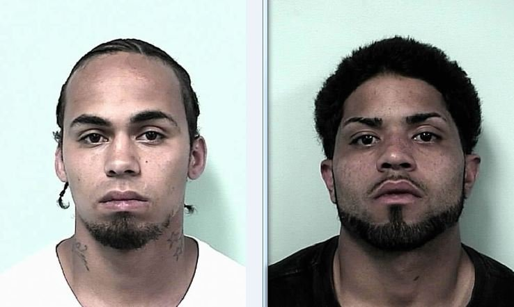 Springfield police charged Hector Lauriano (left) and David Cruz.