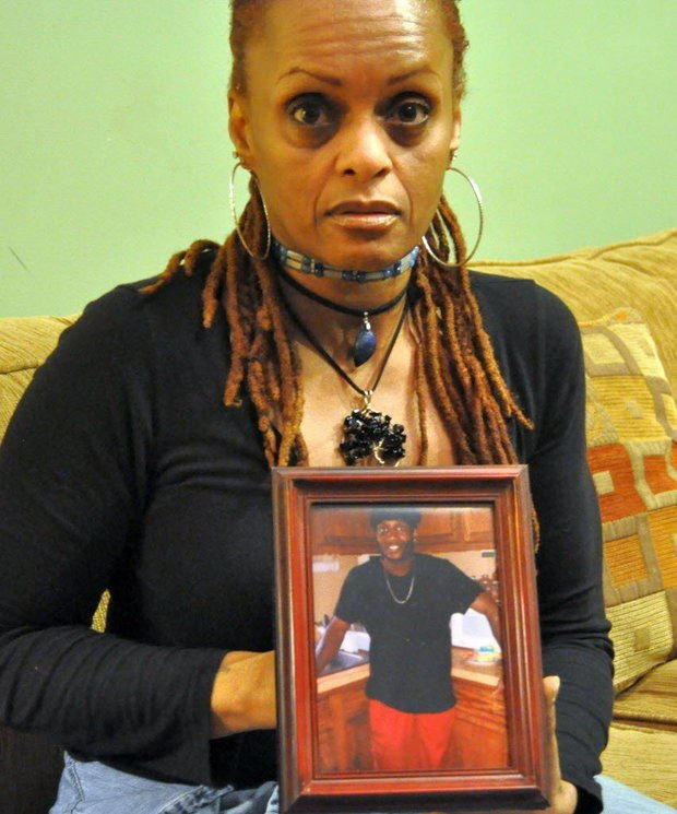 Dee Jones shows and a picture of her son, Wayne Edwards, who was fatally shot by a Massachusetts State Trooper in 2013. (The Republican)