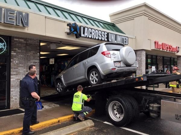 The car was pulled out of the store using a winch. (MassLive).