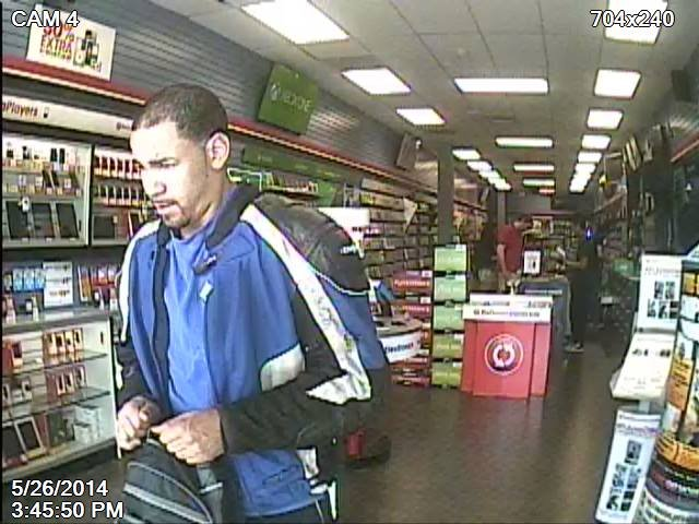 Digital photos from the security system at Game Stop shows the man as he walked out the door.