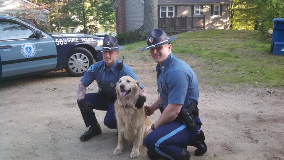 Troopers Paul Bertozzi and Daniel Nunes were slobbered with kisses after rescuing this golden retriever.