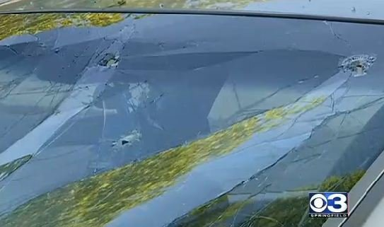 Bullet holes in the windshield of the crashed Nissan Maxima.