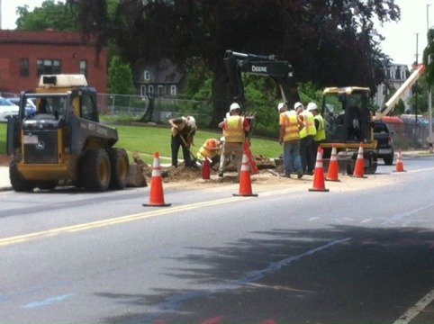 Crews worked to repair the damaged eastbound lane of Carew Street Friday morning.