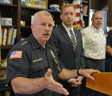 Holyoke Police Chief James Neiswanger stands next to Mayor Alex Morse at a news conference at City Hall on June 2. (MassLive)