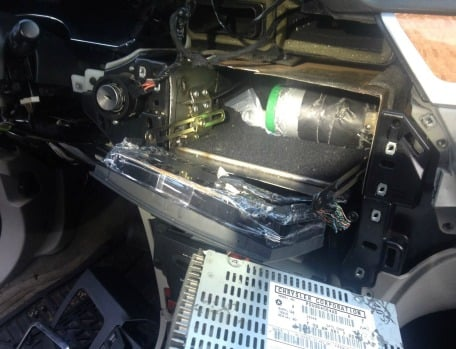 The cocaine troopers discovered in an aftermarket compartment that was built into the dashboard behind a car radio. (Massachusetts State Police)