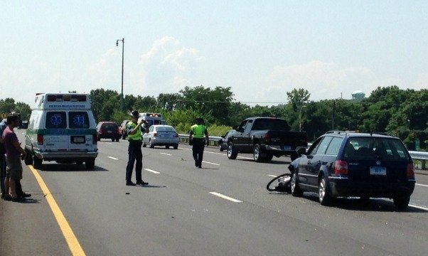 State troopers photograph the accident in the middle lane of I-91.