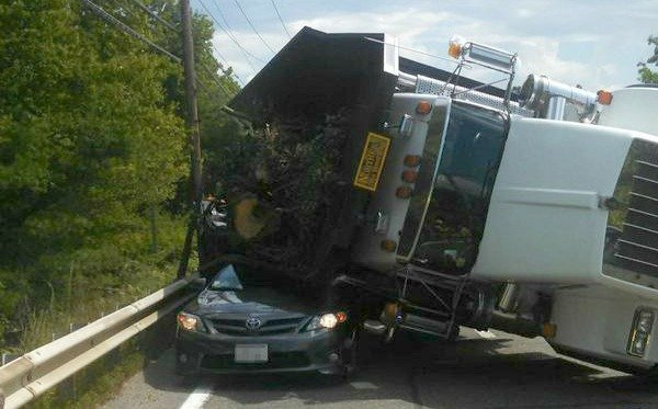 A dump truck rolled over onto a Toyota Corolla traveling westbound on Route 20 in Brimfield. (Massachusetts State Police)
