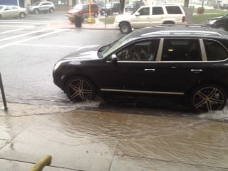 Cars were driving through inches of water as streets flooded in downtown Springfield.