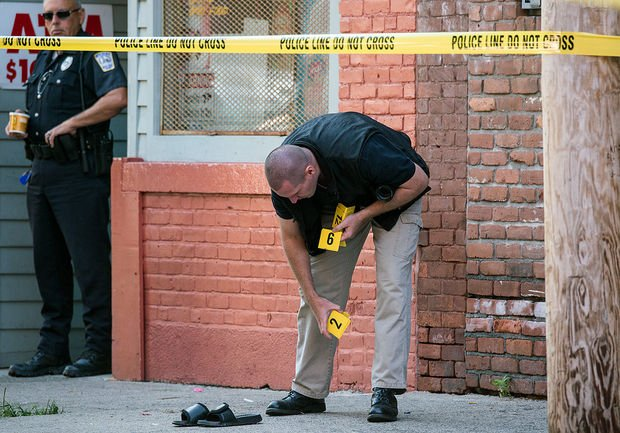 State and Holyoke police continued to investigate the shooting on South Bridge Street Tuesday. (MassLive)