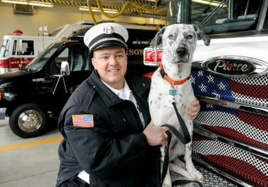 Michael Richard with the department's new dog, Tiller, in 2010. (MassLive)