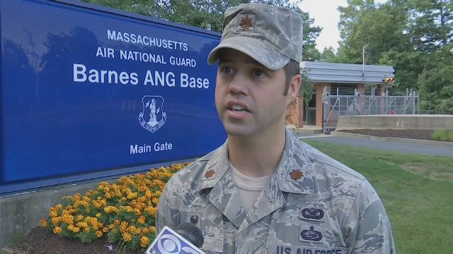 Maj. Matthew Mutti of the 104th Fighter Wing speaks in front of Barnes Air National Guard Base in Westfield.