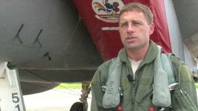 Lt. Col. Morris 'Moose' Fontenot Jr. stands in front of an F-15 at Barnes Air National Guard Base in Westfield, MA (CBS 3 Springfield file photo)