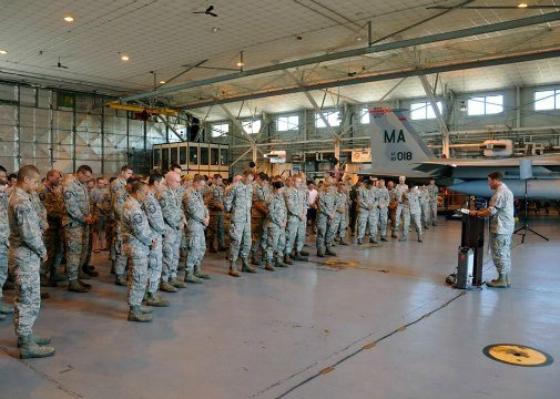 Members of the 104th Fighter Wing joined in a prayer service to remember their fallen comrade and pray for his family. (U.S. Air National Guard photo by Senior Master Sgt. Robert J. Sabonis)