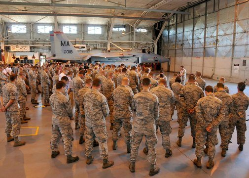 "Members of the 104th Fighter Wing gathered in a hangar to remember Lt. Col. Morris ""Moose"" Fontenot Jr. (U.S. Air National Guard photo by Senior Master Sgt. Robert J. Sabonis)"