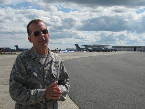 Master Sgt. Andrew Biscoe in front of a fleet of C-5's at Westover