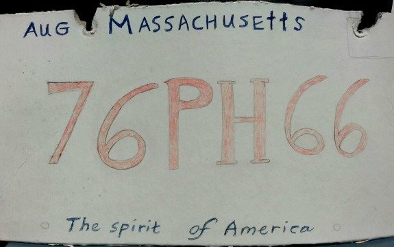 State police pulled over a driver with this cardboard license plate Tuesday morning. (Photo credit: Massachusetts State Police)