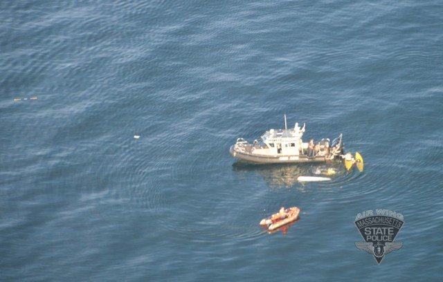 A harbormaster assists the two kayakers about 100 yards from shore. (Massachusetts State Police)