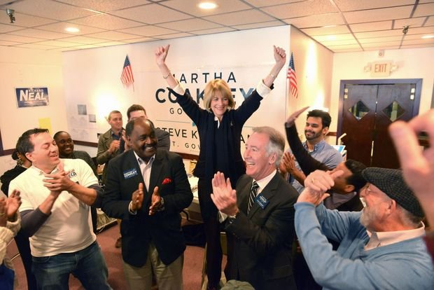Democrat candidate for governor Martha Coakley rallies alongside U.S. Rep. Richard Neal at her Springfield headquarters on State Street Tuesday morning. (MassLive)