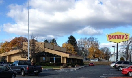 A Holyoke police officer was fired after he drew his handgun and pointed it at another officer following a heated argument inside of the Denny's restaurant located at 2173 Northampton St.