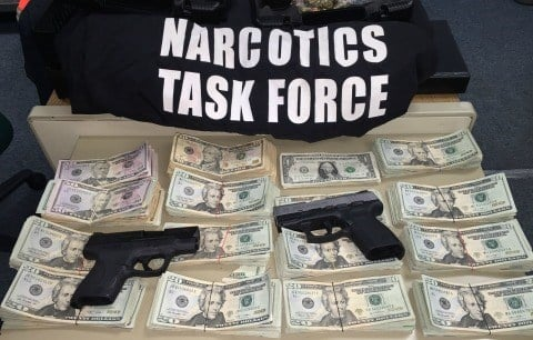 Chicopee police seized $15,000 and two handguns in a drug bust on Tuesday. (CPD)