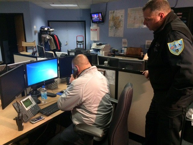"""Springfield police officers answering calls from viewers in the CBS3 newsroom with tips on """"Most Wanted"""" criminals"""