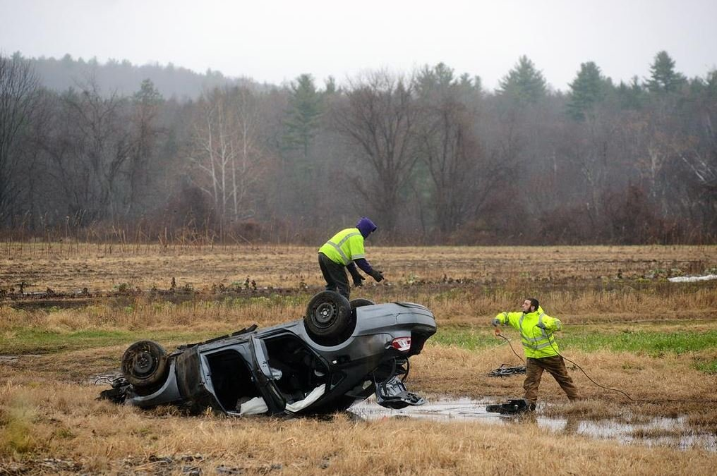 The car slid more than 400 feet across a muddy field before coming to a rest. The victim has been ejected from the vehicle. (MassLive)