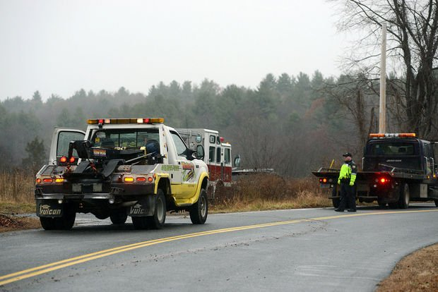 Crews work to recover the vehicle on Root Road. (MassLive)