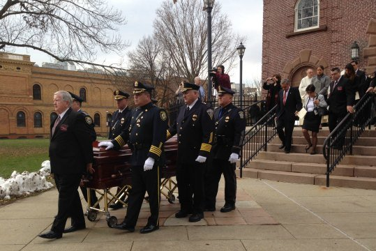 A service for Bishop Joseph Maguire was held at St. Michael's Cathedral at 11 a.m. on Monday.