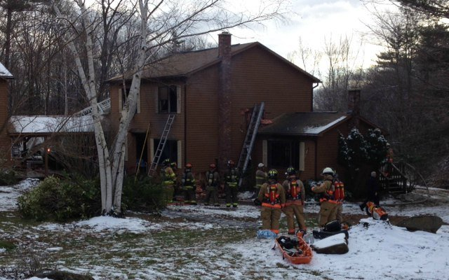 Firefighters worked to extinguish a duplex on Mountain Road in Gill on Friday.