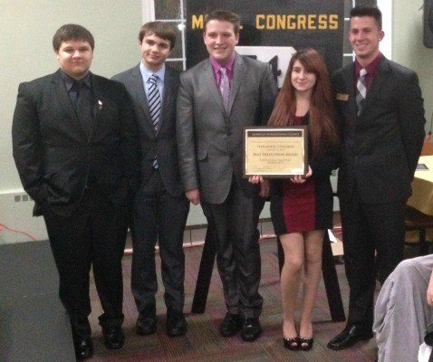 In 2014, the Sabis International Charter School Model Congress team took home the Outstanding Delegation Award. Mauke, second from the right, was awarded a four-year, half tuition scholarship to AIC. (SICS)