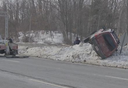 A red Nissan Extera rolled over at the I-91 / I-391 northbound interchange on Wednesday morning.